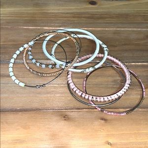 Stack of bracelets from LOFT, pink, gold, white